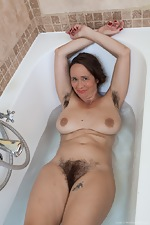Josie strips nude before taking a sexy bath - pic #13