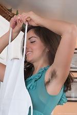 Katie Z strips off blue dress in her kitchen - pic #3