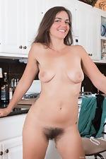 Katie Z strips off blue dress in her kitchen - pic #16
