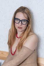 Katya poses in bed with glasses on today - pic #2
