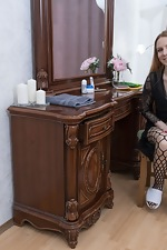 Katya strips naked on her dressing table - pic #1