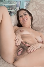 Kaysy strips and gets naked on her sofa  - pic #15