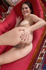 Kaysy strips off dress and lingerie on red chair - pic #8