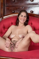 Kaysy strips off dress and lingerie on red chair - pic #14
