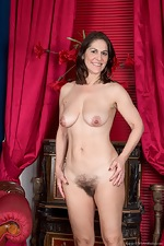 Kaysy strips off dress and lingerie on red chair - pic #15