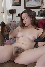 Kelly Morgan strips naked in her living room  - pic #11