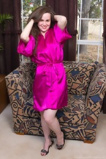 Kelly Morgan strips naked on her sofa - pic #1
