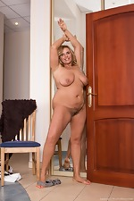 Lariona poses naked and strips in front of mirror  - pic #6