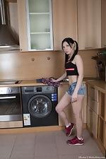 Lilianna poses naked on her washing machine - pic #1