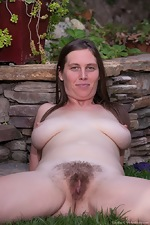 Busty Lindsay strips in outdoor pictorial - pic #14