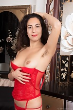 Liz strips naked in her red stockings and red dress - pic #6