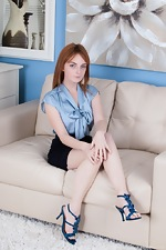 Lola Gatsby strips naked on her leather chair  - pic #1