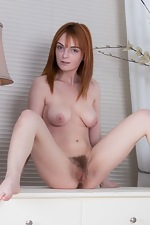 Lola Gatsby strips naked on her leather chair  - pic #14