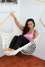 Hairy girl Lucie lounges in her hammock - pic #1