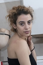 Lula shows her hairy pussy in her kitchen - pic #2