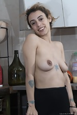 Lula shows her hairy pussy in her kitchen - pic #4