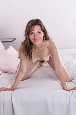 Lulu strips off her black lingerie in bed - pic #16