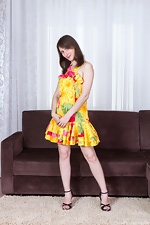 Hairy girl Mary strips off her yellow dress - pic #1