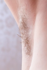 Hairy girl Mary strips off her yellow dress - pic #3