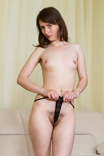 Mary strips on her couch, fondles her hairy pussy - pic #10