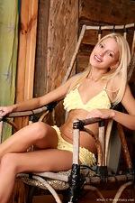 Bikini clad Mbali taking a large dildo - pic #1