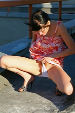 Mila gets kinky on the roof-top - pic #2
