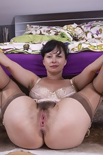 Nikita enjoys having naughty fun in her bedroom - pic #7