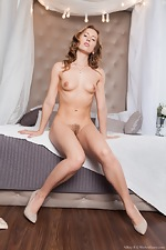 Nikky B strips naked while relaxing in bed  - pic #7