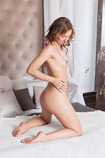 Nikky B strips naked while relaxing in bed  - pic #11