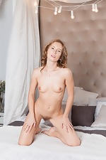 Nikky B strips naked while relaxing in bed  - pic #13