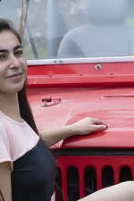 Paris poses naked outdoors by her red jeep - pic #2