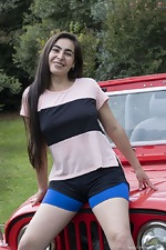 Paris poses naked outdoors by her red jeep - pic #3