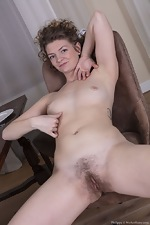 Philippa strips nude by her dining room table - pic #16