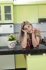 Priscila enjoys naughty fun in her kitchen - pic #1