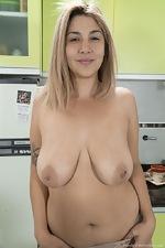 Priscila enjoys naughty fun in her kitchen - pic #3