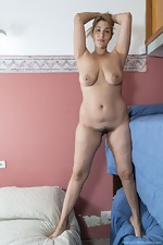 Priscila strips naked by her blue bunk beds - pic #11