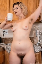 Quinn Helix strips naked in her kitchen - pic #9
