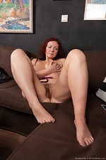 Ranunculus strips nude on her brown couch - pic #5