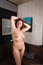 Ranunculus strips nude on her brown couch - pic #6
