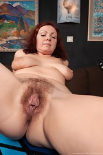 Ranunculus strips nude on her brown couch - pic #13