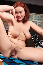 Ranunculus strips nude on her brown couch - pic #14