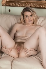 Rebecca Louise strips naked on her couch  - pic #15