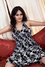 Riani gets risky on a red couch - pic #1