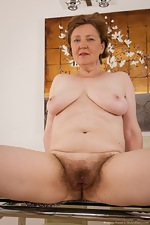 Mature hairy woman Romana Sweet loves her body - pic #11