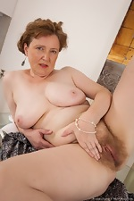 Mature hairy woman Romana Sweet loves her body - pic #16
