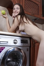 Sandra has fun being naked in her kitchen - pic #14