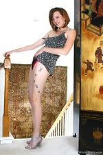 Seductive Sasha strips on the stairs - pic #3