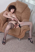 Sasha M spreads her legs on the chair - pic #4