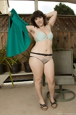 Simone strips naked in her outdoor garden nicely  - pic #6