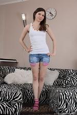 Slava Sanina strips naked on her zebra couch - pic #2
